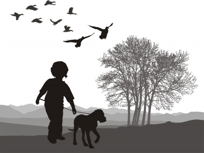 Youngster and dog walking